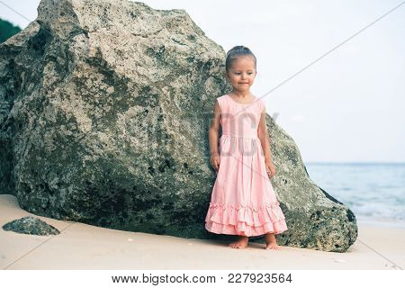Concept, Abstract Image Of Beautiful Little Girl At Beach. Soft Sea Background. Traveling With Child