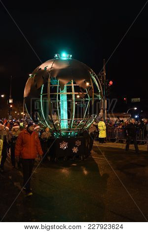 Festival Of Lights Parade, Giant Silver Metal Earth Globe With Green Light Beacon At The North Pole