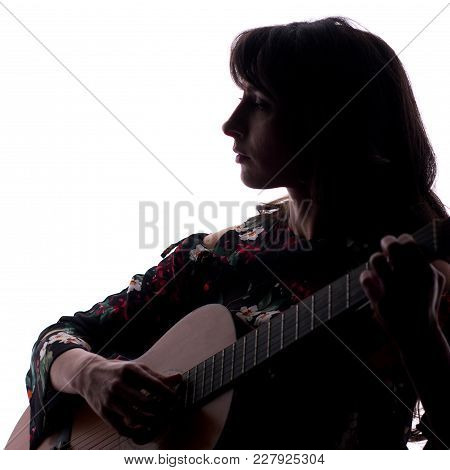 Silhouette. Beautiful Girl With A Guitar On A White Background. A Square Picture. Copy Space.