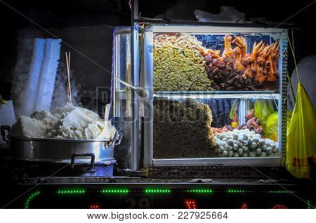 Street Foods In Asia With Stream Rice And Varieties Of Mets