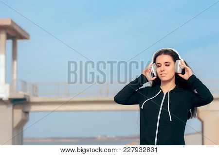 Casual Woman Listening To Music On Her Headphones And Relaxing