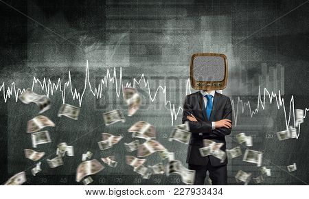 Businessman In Suit With Old Tv Instead Of Head Keeping Arms Crossed While Standing Against Flying D