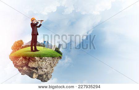 Engineer Man Standing On Green Floating Island In Blue Sky