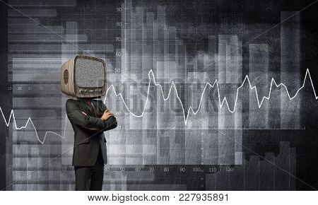 Businessman In Suit With Old Tv Instead Of Head Keeping Arms Crossed While Standing Against Analytic