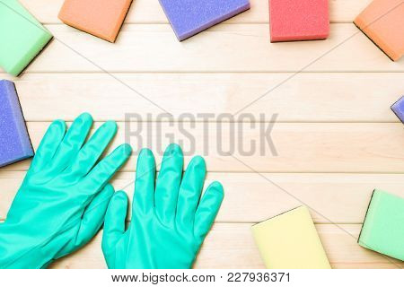 Multicolor Cleaning Sponges On Wooden Background Copy Space