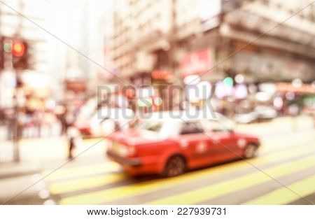 Blurred Defocused Abstract Background Of Red Taxi Cab On Zebra Crossing With Soft Pink Pastel Filter