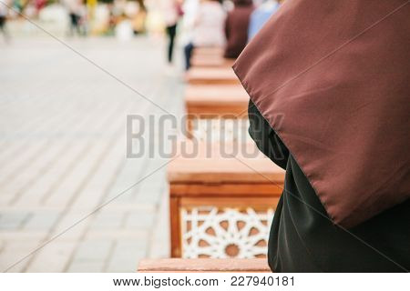 Conceptual Photo Of A Woman Wearing A Hijab Sitting In The Sultanahmet Square In Istanbul, Turkey. N