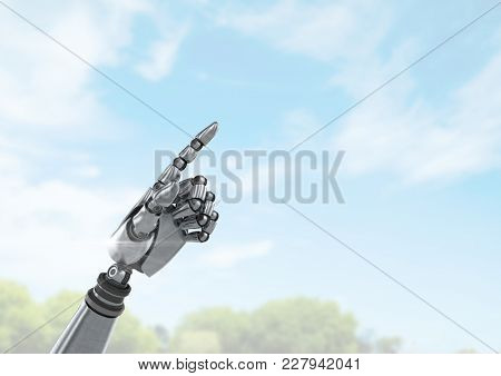 Digital composite of Android Robot hand pointing with bright sky background
