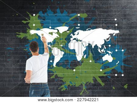 Digital composite of Man painting a Colorful Map with paint splatters on wall background