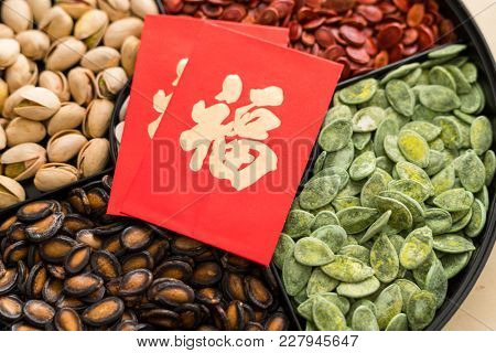 Trdaitional chinese snack tray with red paket word mean luck