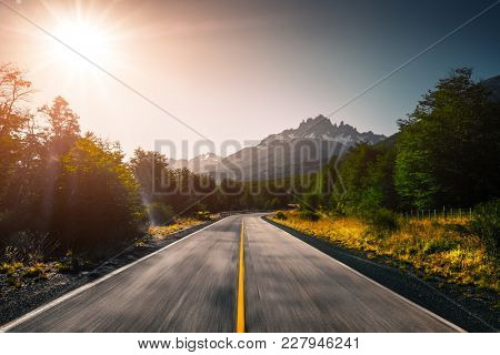 Asphalt blurred road and mountains. Carretera Austral road near the Cerro Castillo mountain (Cerro Castillo peak is on the background). Chile