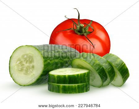 One Whole Tomato And  Smooth Cucumber, Cut Into Pieces, Isolated On A White Background. Half Of Cucu