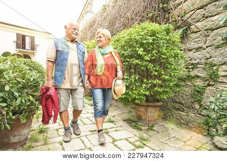 Happy Senior Couple Walking Holding Hand In San Marino Old Town Castle - Active Elderly And Travel L