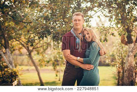 Romantic Happy Couple Hugging In Autumn Park