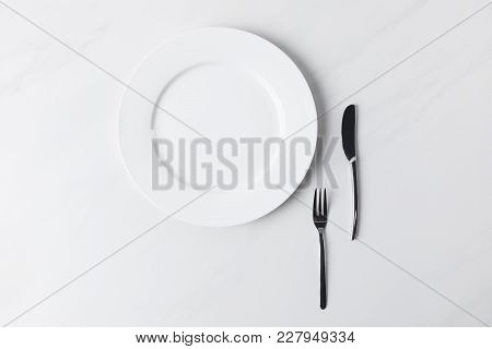 Top View Of Plate With Fork And Knife, Table Appointments Conception
