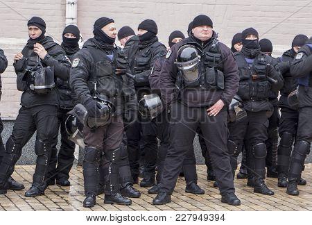Kiev, Ukraine - January 18th: Ukrainian Policemen In Black Uniforms On Mikhailovskaya Square Are Gua