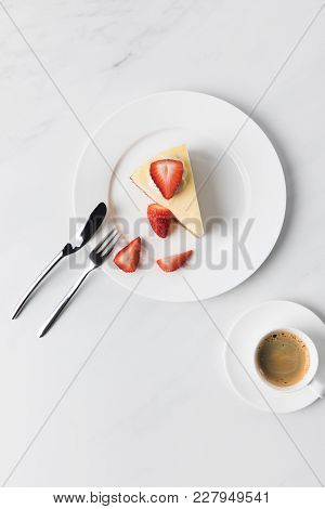 Cutlery, Coffee Cup And Plate With Strawberry Cheesecake