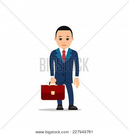 Business Man. Businessman Stands Holding Leather Briefcase In Hand. Dark Blue Suit, Shirt And Red Ti