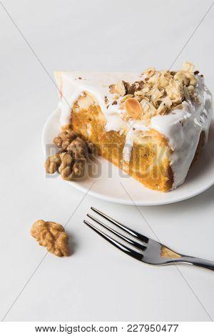 Closeup Of Cake On Plate With Walnuts Around