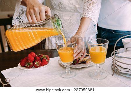 Bride Pours Orange Juice