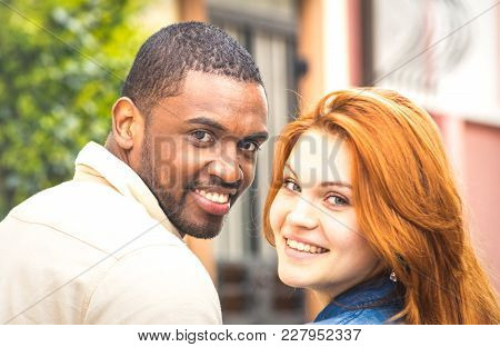 Portrait Of Multiethnic Man And Young Woman Walking Outdoors - Happy Multiracial Couple At Beginning