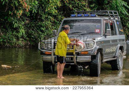 Keningau,sabah-aug 31,2017:man Washing His Four Wheel Drive Pickup Truck With Splashing The Water In