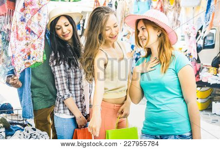 Young Pretty Women Girlfriends At Cloth Flea Market Looking For Fashion Wardrobe - Friendship Concep