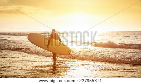 Guy Surfer Walking With Surfboard At Sunset In Tenerife - Surf Long Board Training Practitioner In A