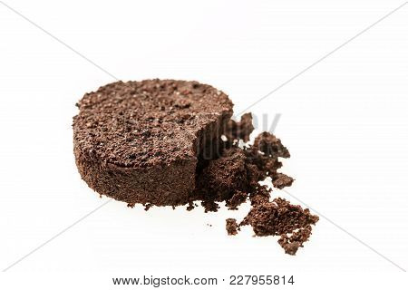 Spent Or Used Coffee Grounds . Waste From The Coffee Machine On White Background.