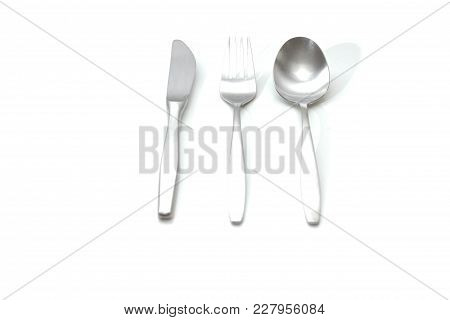 Set Of Knife Spoon And Fork On A White Background