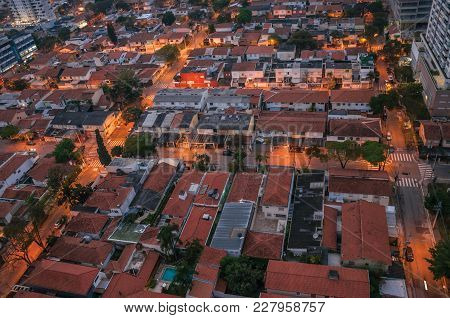 View Of The Streets Lights And House Roofs In The Early Morning Lights, At The City Of São Paulo. Th