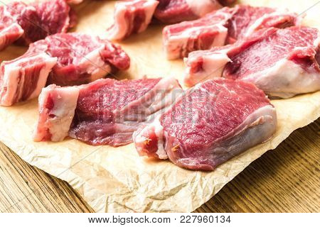 Fresh Lamb Meat On Crumpled Food Paper