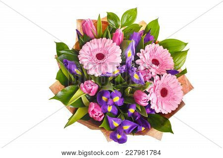 Bouquet Of Pink Gerberas, Violet Irises And Pink, Crimson Tulips In A Package Of Paper. A Holiday, A