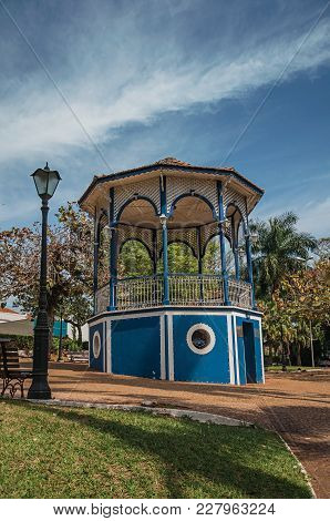 Old Colorful Gazebo And Lighting Pole In The Middle Of Garden With Green Lawn, In A Sunny Day At Sao