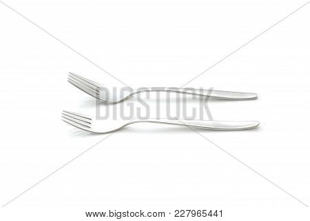 Two Forks On A White Background In A Studio