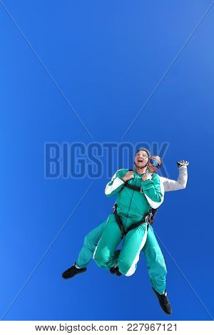 Skydive Instructor And His Student Flying In The Sky After Jump From The Airplane
