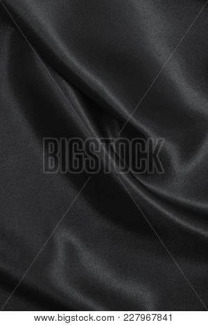 Smooth Elegant Black Silk Or Satin Texture As Abstract Background. Luxurious Background Design