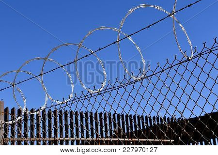 Razor Sharp Concertina Wire On Top Of Fences Which Provide A Border Between Mexico And The Usa