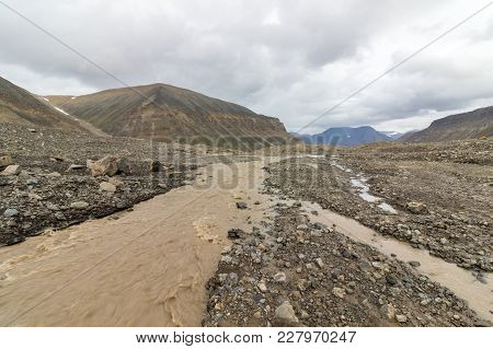 Brown River, The Melting Water From The Longyear Glacier, Running Through The Longyear Valley. Arcti