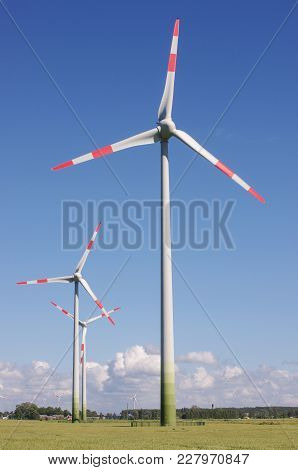 Wind Turbine Surrounded By Nature