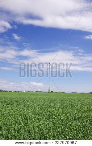 Alternative Energy Recourses Generators - Wind Turbines Surrounded By Nature