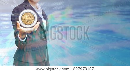 Business Woman Holding Bitcoin With Graph Background.