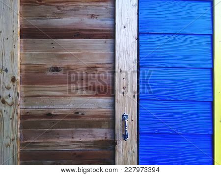 Front Of Wooden Plank Door And Blue Plank Wall