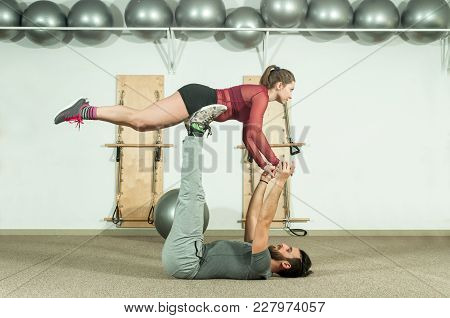Young Beautiful Fitness Couple Workout Yoga Exercise For Long And Healthy Life, Selective Focus