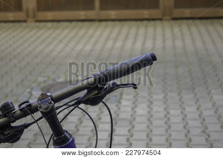 Handlebar With A Battered Grip In The Outdoors
