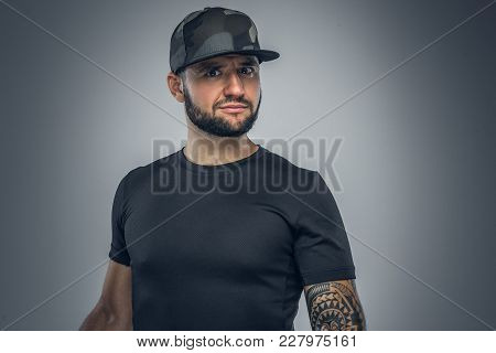 Portrait Of Bearded Male In Baseball Cap Isolated On Grey Background.