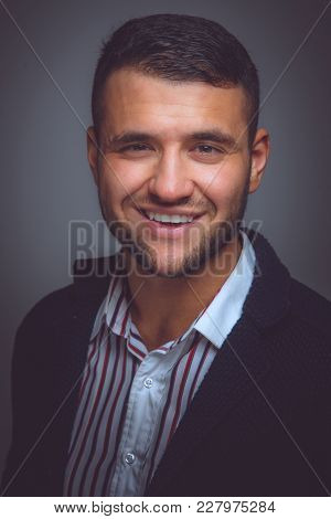 Portrait Of Business Man In A Blue Suit.