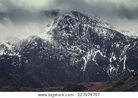 Scenic Mountain Peak Capped In Dramatic Clouds At Winter. Snowdonia National Park In North Wales, Uk