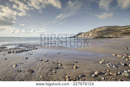 Llandudno Shore Beach At Low Tide In Bright Sunlight. North Wales In United Kingdom