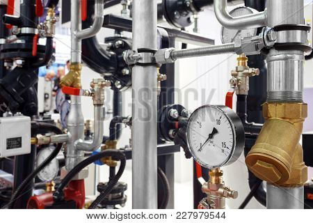 The Equipment Of The Boiler-house, - Valves, Tubes, Pressure Gauges, Thermometer. Close Up Of Manome